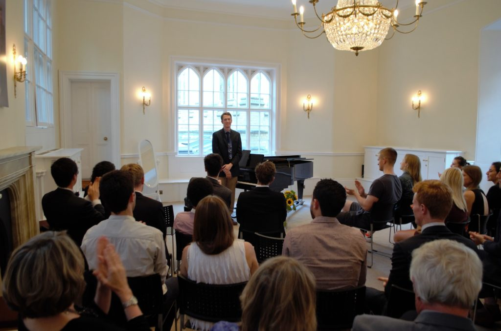 William speaking to the audience during his recital at Trinity College, Cambridge University, in July 2016.